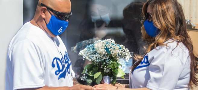 Wedding amidst Covid-19: Philip Hernandez (L) puts the ring on his bride Marcela Peru, as Clerk Recorder Erika Patronas (C) looks on, during their wedding ceremony on April 21, 2020 in Anaheim, California.Apu Gomes | AFP | Getty Images